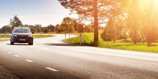 asphalt road view in countryside at beautiful sunset